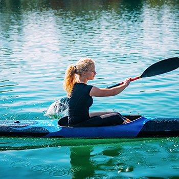 woman on a lake kayaking